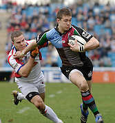 Twickenham, GREAT BRITAIN, Mike BROWN, attacking is tackled by Rob HIGGITT, during the Guinness Premieship match, NEC Harlequins vs Bristol Rugby, at the Twickenham Stoop Stadium, England, on Sat 24.02.2007  [Photo, Peter Spurrier/Intersport-images].....