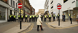 An old women walks in front of a police cordon for the Liberal Democrats conference in Sheffield