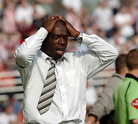 Photo: Kevin Poolman.<br />Swindon Town v Brentford. Coca Cola League 1. 22/04/2006. Swindon Manager Iffy Onuora is not happy after his side lose to Brentford.