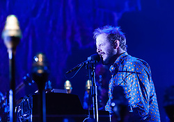 """© Licensed to London News Pictures. 08/11/2012. London, UK.   Justin Vernon of Bon Iver performing live at Wembley Arena. Bon Iver are a Grammy award-winning American folk band founded in 2007 by indie folk singer-songwriter Justin Vernon. In addition to Vernon the band includes Michael Noyce, Sean Carey and Matthew McCaughan.  The name Bon Iver is derived from the French phrase bon hiver, meaning """"good winter"""" or """"have a good winter"""".Photo credit : Richard Isaac/LNP"""