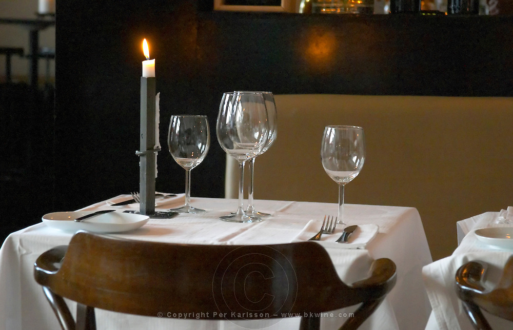 A table with white starched table cloth and glasses. The gastronomic restaurant Tva Bröder, Two Brothers, on Sundstorget. Helsingborg, Skane, Scania. Sweden, Europe.