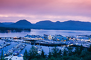 Alaska. Ketchikan. Spruce mill dock area with tour boats, fishing boats, shops, and restaurants, night shot.