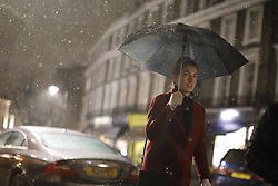 © Licensed to London News Pictures. 12/01/2017. London, UK. People commute in north London whilst the first snow of the season starts to fall in London on Thursday, 12 January 2017. Photo credit: Tolga Akmen/LNP