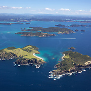 An aerial view of The Bay of Islands, North Island, New Zealand. .The Bay of Islands boasts a unique coastline sheltering over 150 small islands in its arms. Once a seafaring and whaling region the Bay of Islands is today a popular tourist destination recognised for it's cultural heritage as well as it's amazing scenery and wildlife. Small towns are scattered along the coastline. There are a lot of water-based activities, including kayaking, swimming with dolphins, game fishing and boating and whales and dolphins can often be seen in the bay. Bay of Islands, New Zealand, 16th November 2010. Photo Tim Clayton.