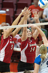 25 SEP 2005<br /> <br /> Illinois State Redbirds Emily Kabbes and Laura Doornbos combine for a block attempt on a hit from Creighton Bluejays Jessica Houts.<br /> <br /> The Creighton Bluejays failed to win a single game as the Illinois State Redbirds won 3 in a row to settle the match.  Play took place at Redbird Arena on the campus of Illinois State University in Normal IL.