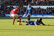Birmingham City's Clayton Donaldson tackles Forest's Michael Mancienne during the Sky Bet Championship match between Nottingham Forest and Birmingham City at the City Ground, Nottingham, England on 28 December 2014. Photo by Jodie Minter.