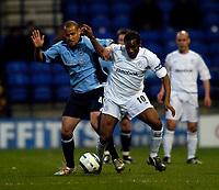 Fotball<br /> England 2004/2005<br /> Foto: SBI/Digitalsport<br /> NORWAY ONLY<br /> <br /> Bolton Wanderers v Southampton, Barclays Premiership, 19/04/2005.<br /> Southampton's Jay Jay Okocha (R) fights off Southampton's Nigel Quashie