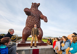 Dunbar, East Lothian, Scotland, United Kingdom, 19 November 2019. Andy Scott statue unveiling: Unveiling today of a 5m high bear sculpture to celebrate the life of naturalist John Muir. The sculpture by the Kelpies creator Andy Scott marks Dunbar-born John Muir who played a key role in the development of national parks in the US. Pictured: Andy Scott (sculptor) and children from Primary 4 at Dunbar Primary School.<br /> Sally Anderson | EdinburghElitemedia.co.uk