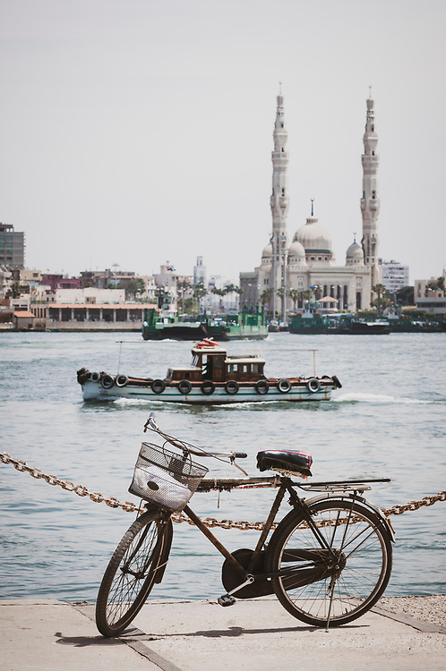 Port Said, Egypt - April 24, 2010: A bicycle parked at the busy port of Port Said