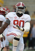 Alabama Crimson Tide defensive lineman Quinton Dial (90) warms up before the game. The Alabama Crimson Tide defeated the Missouri Tigers 42-10 at Memorial Stadium in Columbia, Missouri on October 13, 2012.