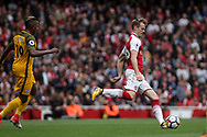 Rob Holding Of Arsenal passes under pressure from Jose Izquierdo of Brighton and Hove Albion.<br /> Premier league match, Arsenal v Brighton & Hove Albion at the Emirates Stadium in London on Sunday 1st October 2017. pic by Kieran Clarke, Andrew Orchard sports photography.
