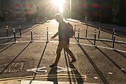 With most Londoners still working from home, a commuter walks around the widened corner of Threadneedle and Old Board Streets at evening rush-hour during the third lockdown of the Coronavirus in the City of London, the capital's financial district, on 26th February 2021, in London, England.