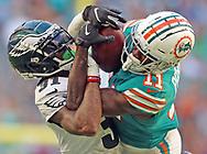 Miami Dolphins wide receiver DeVante Parker (11) battles with Philadelphia Eagles cornerback Jalen Mills (31) in the fourth quarter as the Miami Dolphins host the Philadelphia Eagles at Hard Rock Stadium in Miami Gardens on Sunday, December 1, 2019.