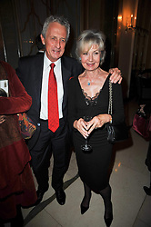 LADY RAYNE and ROBERT LACEY at a party to celebrate the publiction of 'No Invitation Required' by Annabel Goldsmith, held at Claridge's, Brook Street, London on 11th November 2009.