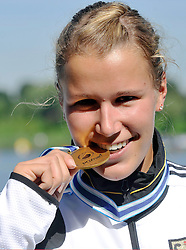 FRANZISKA WEBER (GERMANY) POSES WITH HER GOLD MEDAL IN WOMEN'S K1 1000 METERS FINAL A RACE DURING 2010 ICF KAYAK SPRINT WORLD CHAMPIONSHIPS ON MALTA LAKE IN POZNAN, POLAND...POLAND , POZNAN , AUGUST 21, 2010..( PHOTO BY ADAM NURKIEWICZ / MEDIASPORT ).