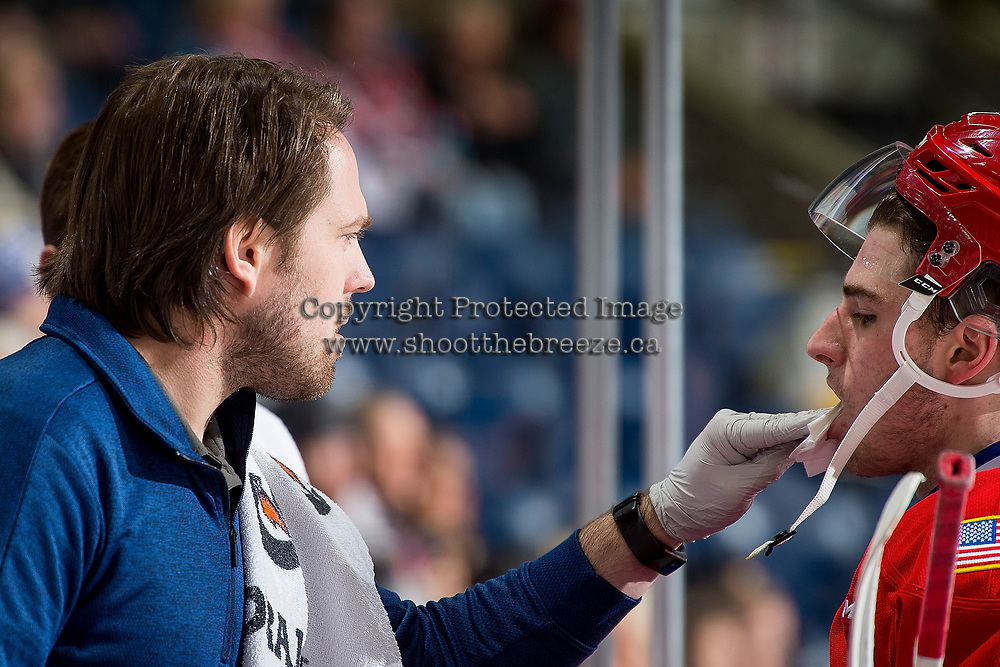 KELOWNA, CANADA - FEBRUARY 6: Spokane Chiefs' athletic therapist Joe Hurley tends to a player on the bench against the Kelowna Rockets on February 6, 2019 at Prospera Place in Kelowna, British Columbia, Canada.  (Photo by Marissa Baecker/Shoot the Breeze)