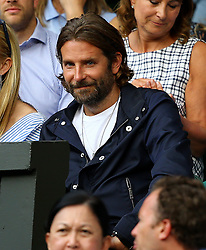 Bradley Cooper watches the action between Thomas Berdych and Roger Federer on day eleven of the Wimbledon Championships at The All England Lawn Tennis and Croquet Club, Wimbledon.