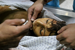 October 5, 2018 - The body of 12-year-old Faras Hafez Assarsawei in the Shifa hospital in Gaza City who died after being shot by Israeli Security Forces during demonstrations on the east of Gaza City on 5rd October 2018. Thousands of Palestinians attended the Great March of Return rally at different sites along the Gaza-Israeli border this Friday and according to the Gaza Health Ministry three Palestinian protesters were killed today as a result of Israeli live fire, while over a hundred were injured by Israeli live ammunition and tear gas fired at the them by the Israeli army. At least 193 Palestinians have been killed and over 21,000 have been injured since the Great March of Return protests started on March 30th (Credit Image: © Ahmad Hasaballah/IMAGESLIVE via ZUMA Wire)