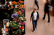 A man passes the flower shop in Denver's Union Station Great Hall in downtown Denver, Colorado U.S. November 1, 2017. REUTERS/Rick Wilking