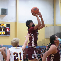Shiprock Chieftain Shannon Dale (32) takes a shot against Rehoboth Lynx Tuesday at Rehoboth Christian School in Rehoboth.