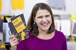 """© Licensed to London News Pictures . 14/09/2019. Bournemouth, UK. Party leader JO SWINSON holds up a signed copy of the Lib Dem manifesto with """" Bollocks to Brexit on the front cover """" during a tour of the exhibition at the conference . The first day of the Liberal Democrat Party Conference in Bournemouth . Photo credit: Joel Goodman/LNP"""