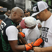 LAS VEGAS, NV - APRIL 14: WBC/WBA welterweight champion Floyd Mayweather Jr. changes into a new pair of gloves as he works out at the Mayweather Boxing Club on April 14, 2015 in Las Vegas, Nevada. Mayweather will face WBO welterweight champion Manny Pacquiao in a unification bout on May 2, 2015 in Las Vegas.  (Photo by Alex Menendez/Getty Images) *** Local Caption *** Floyd Mayweather Jr.