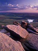 Weathered gritstone boulders line the edges of Kinder Scout, the highest moorland in the Peak District