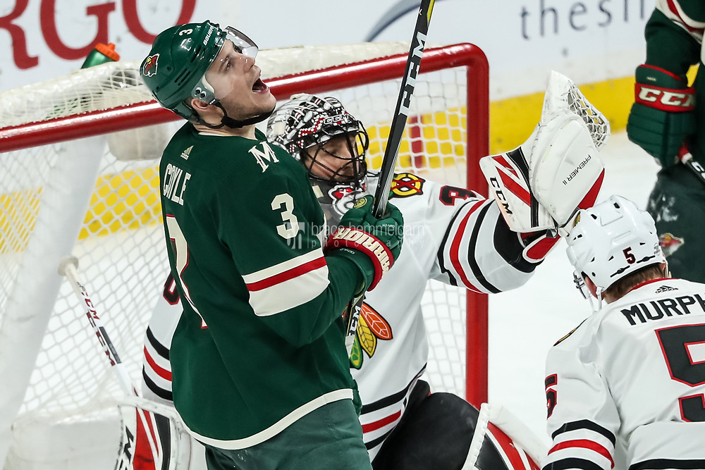 Feb 10, 2018; Saint Paul, MN, USA; Minnesota Wild forward Charlie Coyle (3) reacts after Chicago Blackhawks goalie Jeff Glass (30) makes a save during the third period at Xcel Energy Center. Mandatory Credit: Brace Hemmelgarn-USA TODAY Sports