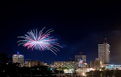 Fireworks over downtown South Bend, Indiana...Photo by Matt Cashore..Use of this image prohibited without authorization and/or compensation..To contact Matt Cashore:.574.220.7288.574.233.6124.cashore1@michiana.org.www.mattcashore.com