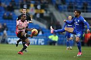 Joel Asoro of Sunderland is challenged by Liam Feeney of Cardiff city.  EFL Skybet championship match, Cardiff city v Sunderland at the Cardiff city stadium in Cardiff, South Wales on Saturday 13th January 2018.<br /> pic by Andrew Orchard, Andrew Orchard sports photography.