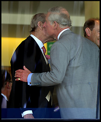 Image ©Licensed to i-Images Picture Agency. 18/06/2014. Ascot, United Kingdom. The Duke of Edinburgh kisses his son The Prince of Wales in the Royal Box on Day 2 of Royal Ascot at Ascot Racecourse. Picture by Andrew Parsons / i-Images