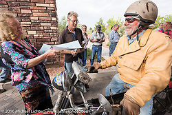 Frank Westfall of NY on his 1912 Henderson checks in at the finish line in Page, AZ and receives his directions for Stage 12 during the Motorcycle Cannonball Race of the Century. Stage-11 ride from Durango, CO to Page, AZ. USA. Wednesday September 21, 2016. Photography ©2016 Michael Lichter.