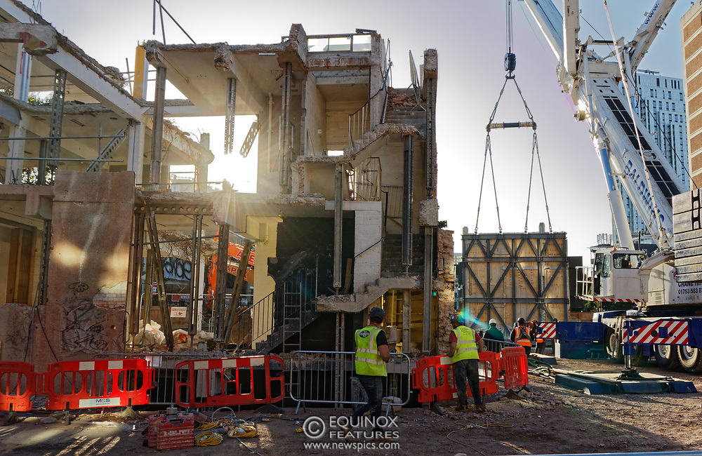 London, United Kingdom - 20 September 2019<br /> EXCLUSIVE SET - Aerial construction specialists and demolition experts use a huge crane to carefully lift intact, a twenty five ton, two-story wall, to preserve a famous Banksy rat image which has been covered up for years. Teams from specialist companies have spent over six weeks cutting around the artwork and fitting custom made eight ton steel supports to enable them to save the historic piece of art. Work has started on the construction of a new twenty seven floor art'otel hotel on the site of the old Foundry building in Shoreditch, east London, and a condition of the planning permission was to preserve the historical Banksy graffiti. A second section of the painting, an image of a TV being thrown through a broken window has already been cut out and moved separately. After the hotel construction is complete the two parts of the Banksy painting will be displayed on the hotel. Our pictures show the stages of work to protect the image, culminating in the lifting of the three story wall by crane. Video footage also available.<br /> (photo by: EQUINOXFEATURES.COM)<br /> Picture Data:<br /> Photographer: Equinox Features<br /> Copyright: ©2019 Equinox Licensing Ltd. +443700 780000<br /> Contact: Equinox Features<br /> Date Taken: 20190920<br /> Time Taken: 17352423<br /> www.newspics.com