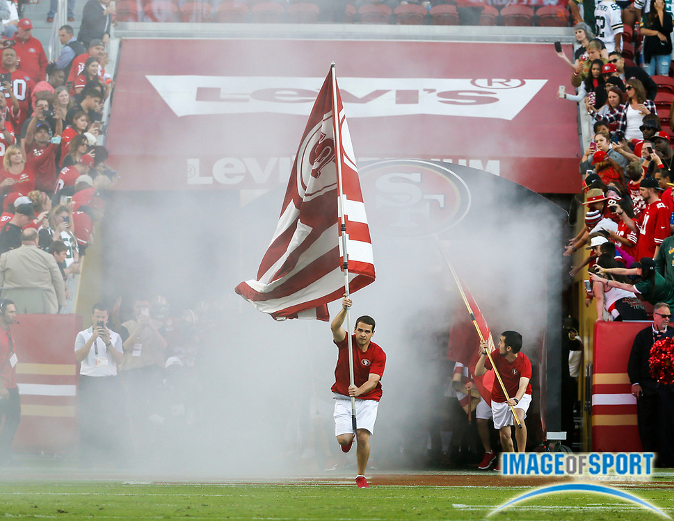 Aug 26, 2016, Santa Clara, CA, USA; Cheerleaders lead the team onto the field prior to San Francisco 49ers against the Green Bay Packers in a preseason NFL game at Levi's Stadium.