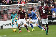 Juanma Dalgado battles Brad McKay during the Ladbrokes Scottish Premiership match between Heart of Midlothian and St Johnstone at Tynecastle Stadium, Gorgie, Scotland on 2 August 2015. Photo by Craig McAllister.
