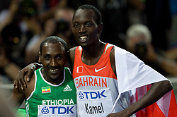 Yusuf Saad Kamel of Bahrain celebrates winning the gold medal and Deresse Mekonnen of Ethiopia the silver medal in the men's 1500 Metres Final during day five of the 12th IAAF World Athletics Championships at the Olympic Stadium on August 19, 2009 in Berlin, Germany. (Photo by Vid Ponikvar / Sportida)