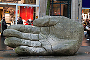 Big hand sculpture on the Meir shopping street in Antwerpen, Belgium