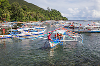 Filipino Outrigger - An outrigger is a part of a boat's rigging which is rigid and extends beyond the side or gunwale of a boat. The outrigger is positioned rigidly and parallel to the main hull so that the main hull is less likely to capsize. If only one outrigger is used on a vessel, its weight reduces the tendency to capsize in one direction and its buoyancy reduces the tendency in the other direction.