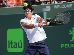 March 28, 2018 - Key Biscayne, Florida, United States - Hyeon Chung, from Korea, in action during his fourth round match against John Isner, from the USA. Isner finally prevailed and defeated Chung 6-1, 6-4 for a pass to the Semifinals of the Miami Open in Miami, on March 28, 2018. (Credit Image: © Manuel Mazzanti/NurPhoto via ZUMA Press)