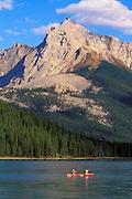 Canoe on Maligne Lake under Mount Sampson, Jasper National Park, Alberta, Canada.