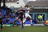 Carlisle United's James Berrett and Tranmere Rovers' Max Power in an aerial battle. Skybet football league 1 match, Tranmere Rovers v Carlisle United at Prenton Park in Birkenhead, England on Saturday 29th March 2014.<br /> pic by Chris Stading, Andrew Orchard sports photography.