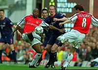 Fotball. Engelsk Premier League 2001/2002.<br /> Arsenal v Sunderland. 30.03.2002.<br /> Fredrik Ljungberg og Sylvain Wiltord, Arsenal.<br /> Jody Craddock, Sunderland.<br /> Foto: Andrew Cowie, Digitalsport