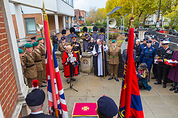 The Mayor of Haringey Cllr Gina Adamou delivers her address as local residents, family members and representatives of the Armed Forces honour Lieutenant-Colonel Sir Brett Mackay Cloutman VC MC KC with the unveiling of the final London Victoria Cross Commemorative paving stone in Hornsey, London. November 06 2018.