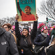 """Tiffany Harris, a DC resident, holds up a sign supporting indigenous rights during the Women's March on Washington where an anticipated 200,000 people turned into an estimated 500,000 to 1 million people, on Saturday, January 21, 2017.  Harris' father is is a mix between Ponca and Puyallup tribes, while her mother is Jewish.  Her grandparents are survivors of the Holocaust.  When asked about her hopes for the next 4 years, Harris said, """"I hope that we're all wary of [President Trump]...we've seen he's a dangerous and divisive man...but he works for us and I hope he takes that seriously.""""  She also added, """"...we're very afraid and hope he doesn't undo all the work we've done...""""  John Boal Photography"""
