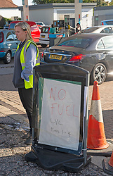 © Licensed to London News Pictures 29/09/2021.<br /> Swanley, UK, Only unleaded sign pumps 1 and 4. The petrol shortage continues today with motorists queuing for hours at this Co-op petrol station in Swanley, Kent. This station only had unleaded left at two pumps at 10.30am, staff said the station will be empty within two hours. Photo credit:Grant Falvey/LNP