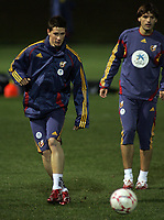 Photo: Paul Thomas.<br />Spain training session. 05/02/2007.<br /><br />Fernando Torres (L) in action during training, watched by Fernando Morientes.