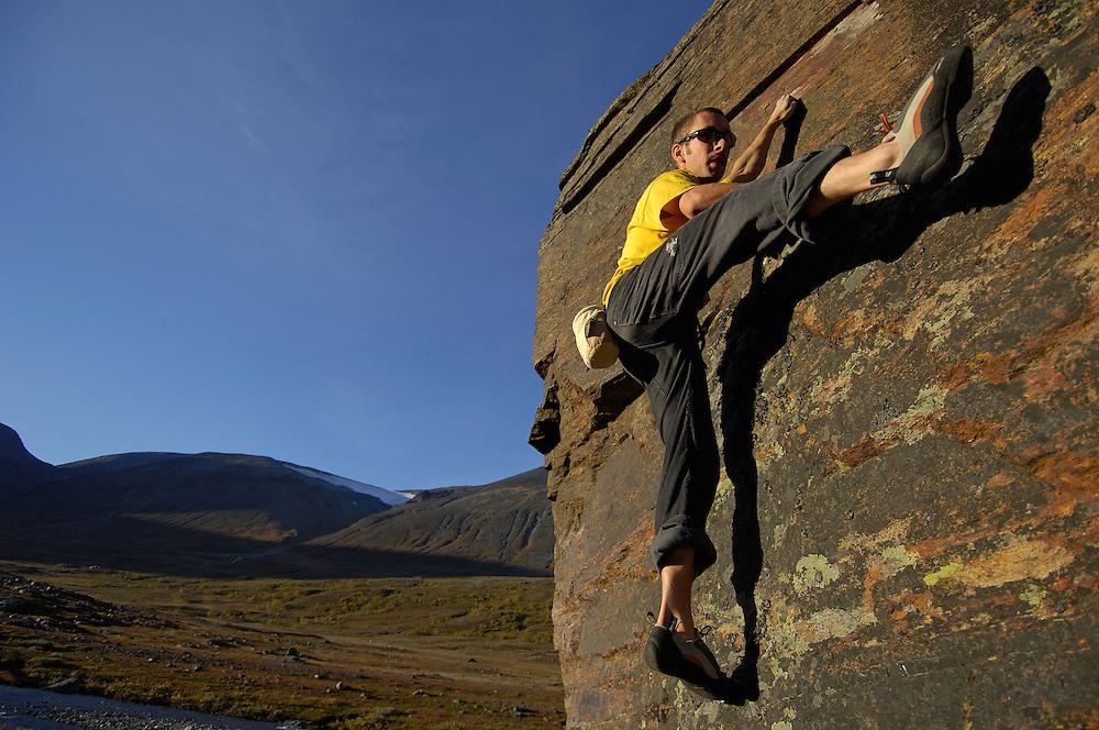 Hiker Pontus Tengvall, in front of Duolpaguornij mountain, Lapland, Sweden