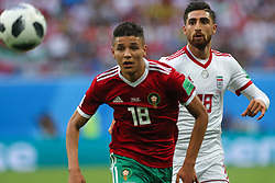 June 15, 2018 - Saint Petersburg, Russia - Amine Harit (L) of the Morocco national football team and Alireza Jahanbakhsh of the Iran national football team vie for the ball during the 2018 FIFA World Cup match, first stage - Group B between Morocco and Iran at Saint Petersburg Stadium on June 15, 2018 in St. Petersburg, Russia. (Credit Image: © Igor Russak/NurPhoto via ZUMA Press)