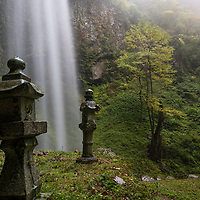 """Dangyo-no-taki Waterfalls is known for its sacred """"winning"""" water which sumo wrestlers or owners of bull sumos would bathe in before competitions. The male waterfall (pictured) flows next to a beautiful shrine. Dangyo Falls is located on Dogo, the largest island of the Oki Islands which is an archipelago in the Sea of Japan, Shimane Prefecture, Japan."""