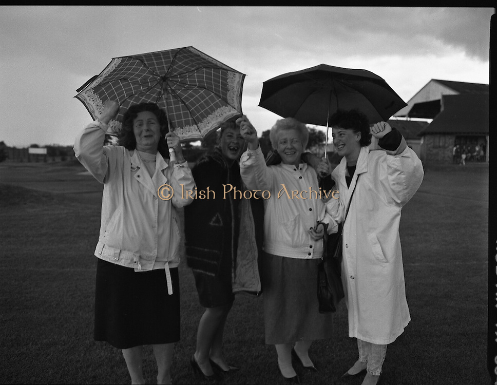 """Guinness Family Day At The Iveagh Gardens. (R83)..1988..02.07.1988..07.02.1988..2nd  July 1988..The family fun day for Guinness employees and their families took place at the Iveagh Gardens today. Top at the bill at the event were """"The Dubliners"""" who treated the crowd to a performance of all their hits. Ireland's penalty hero from Euro 88, Packie Bonner, was on hand to sign autographs for the fans...This group of ladies are pictured cheering the winning seven a side soccer team."""